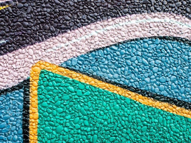 Modello dipinto variopinto della decorazione della parete della roccia immagine stock libera da diritti