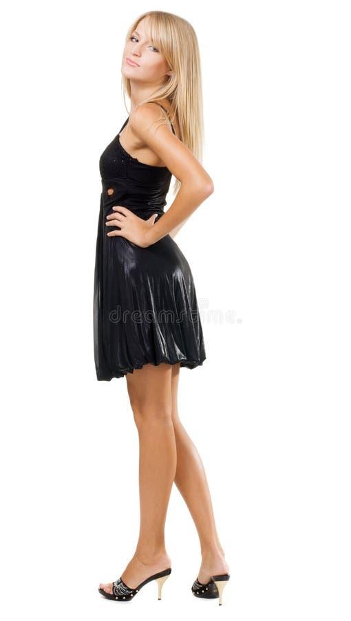 Modello elegante in abito nero immagini stock