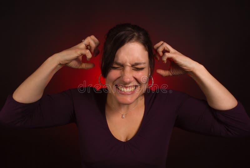 Modello femminile con PMS, esaurimento nervoso fotografia stock libera da diritti