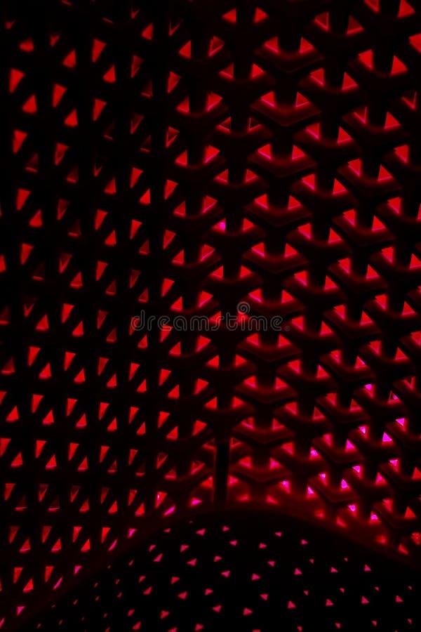 Modello intrecciato multidimensionale del fondo in rosso ed in nero fotografie stock