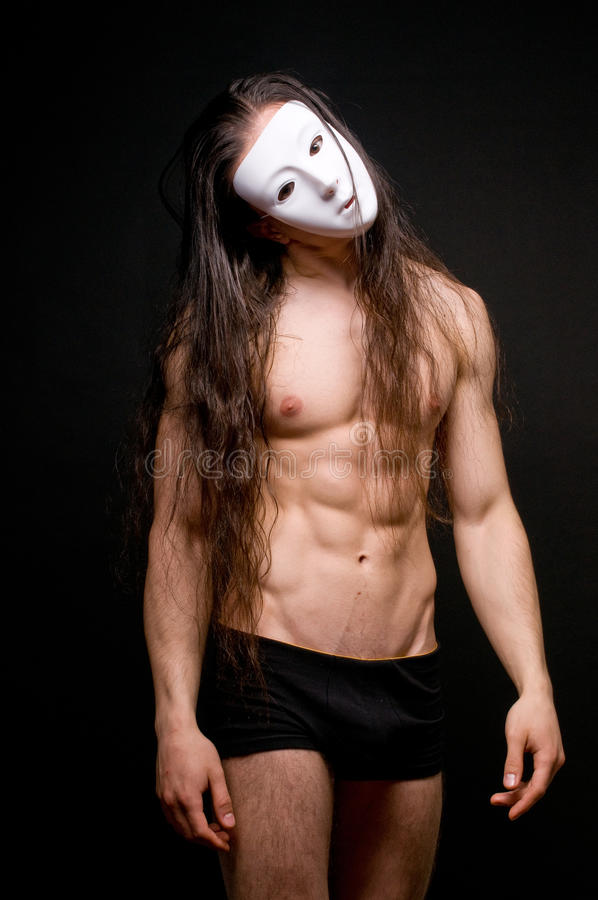 Modello nella mascherina immagine stock