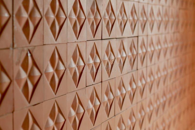 Modello piastrellato per il muro di mattoni rosso ripiegato continuo fotografia stock