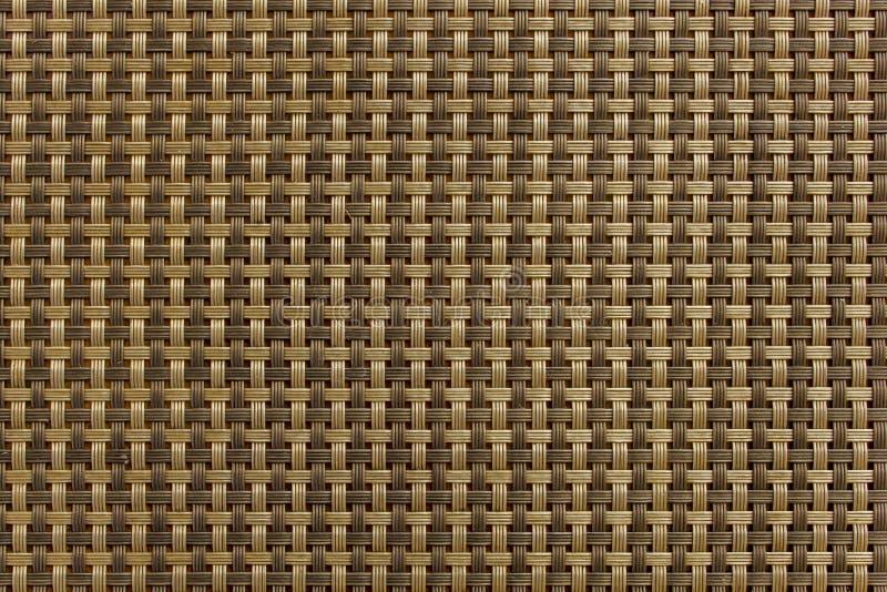 Modello a quadretti intrecciato delle linee marroni e beige Struttura della superficie ruvida fotografia stock libera da diritti