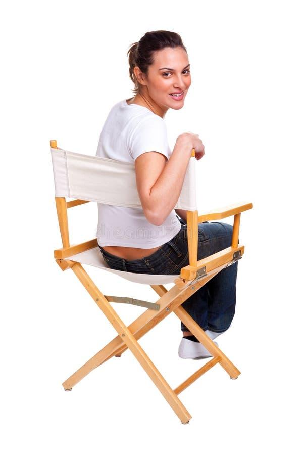 Modello seduto in una presidenza fotografia stock libera da diritti