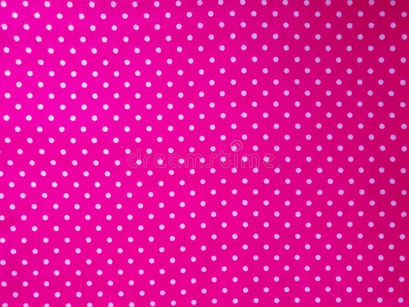 Modello, struttura, fondo, carta da parati Campione rosa luminoso molle del cotone con i punti bianchi, con l'ornamento geometric immagini stock