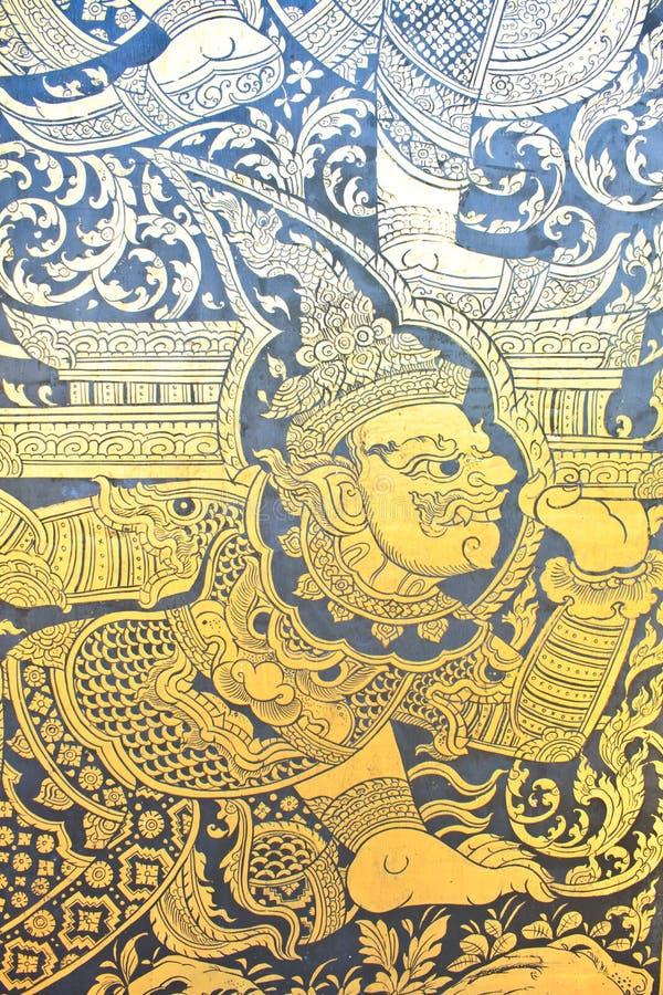 Modello tailandese tradizionale della pittura dell'oro di arte di stile sulla porta immagine stock