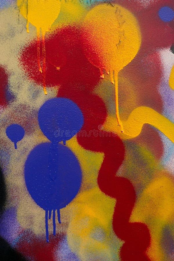 Modelo abstracto con las pinturas del color en la pared Textura de los puntos de la pintura y de las manchas coloridas Art Bright imagenes de archivo
