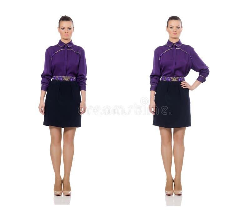 Modelo bonito que lleva la blusa p?rpura aislada en blanco imágenes de archivo libres de regalías