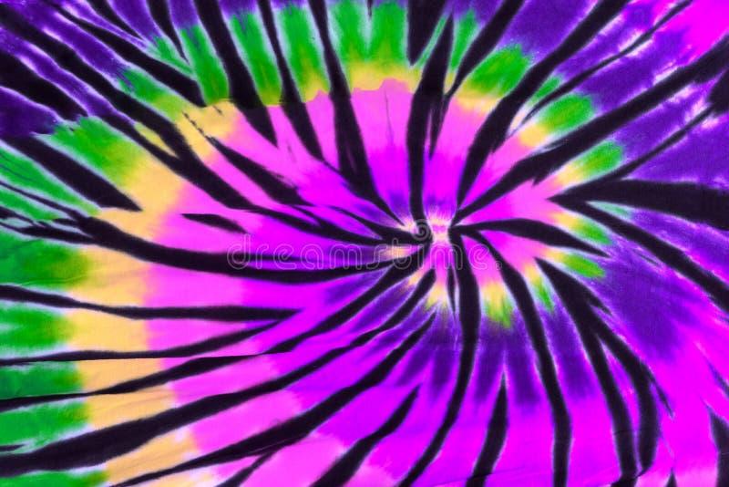 Modelo colorido del diseño del espiral del remolino del teñido anudado imagenes de archivo