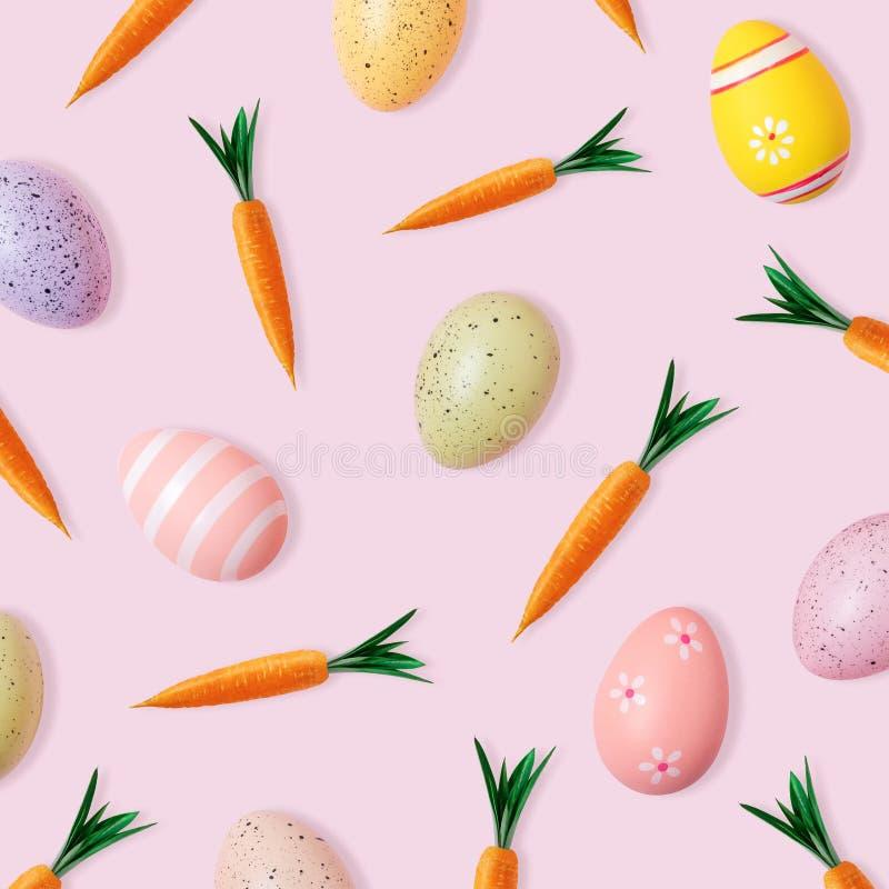 Modelo creativo de Pascua de zanahorias y de huevos coloridos en fondo rosado Composici?n m?nima de Pascua Endecha plana stock de ilustración