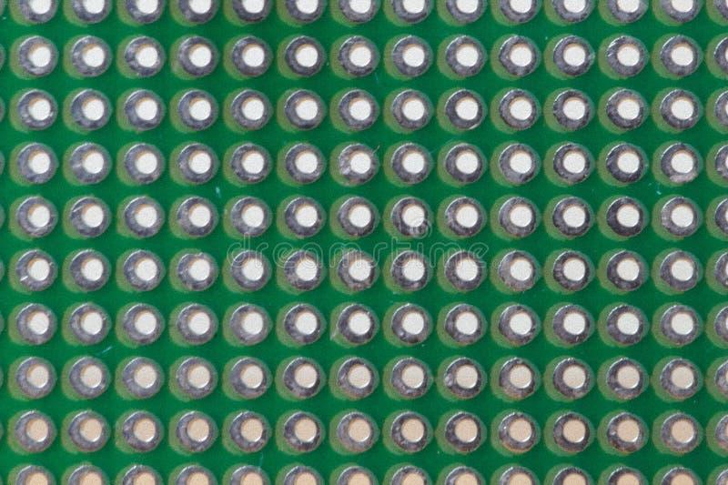 Modelo de agujero en un protoboard verde foto de archivo libre de regalías