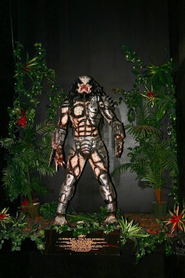 Modelo de cera do predador na selva imagem de stock