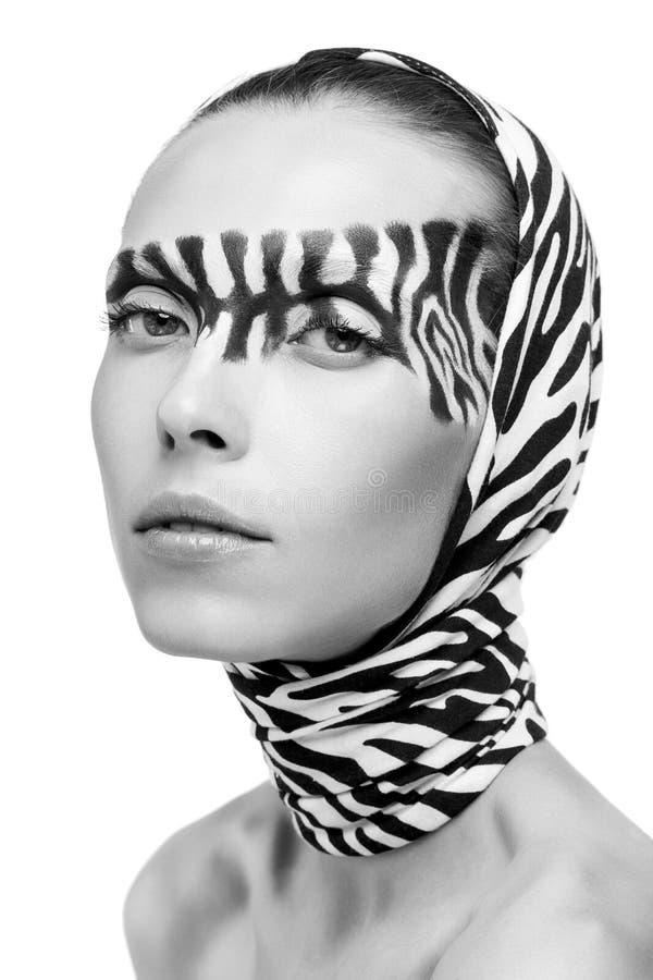 Modelo de forma bonito em uma zebra fotos de stock royalty free