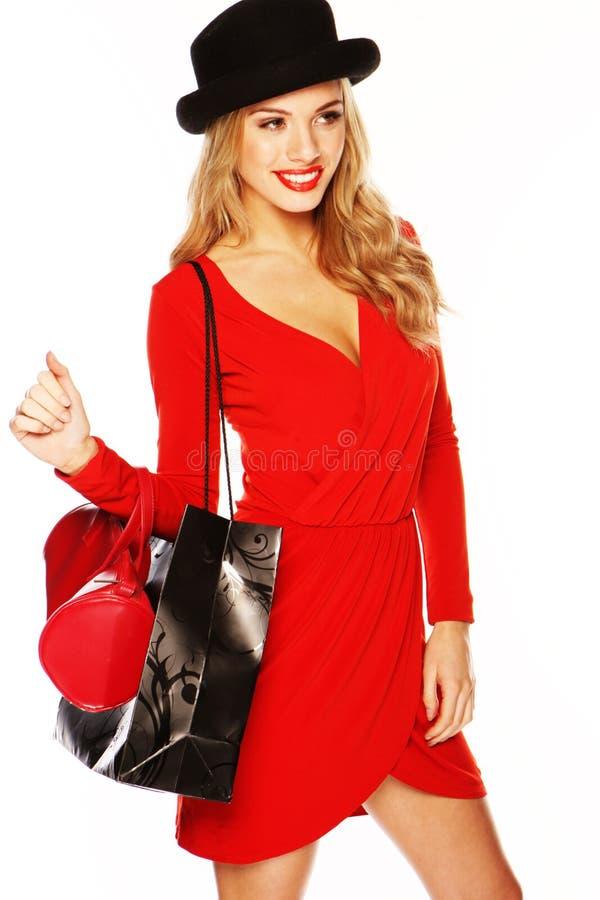 Modelo de forma que desgasta o equipamento vermelho 'sexy' fotos de stock