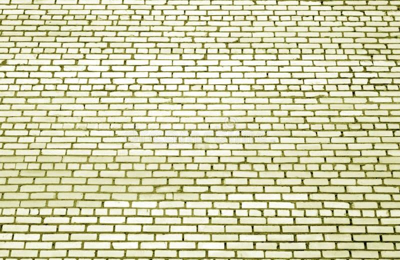 Modelo de la pared de ladrillo con efecto de la falta de definición en tono amarillo imagen de archivo libre de regalías
