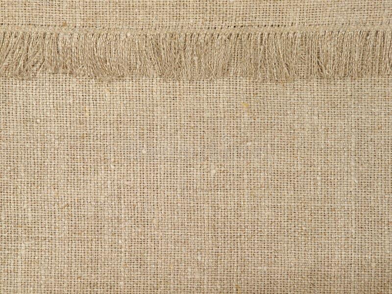 Modelo de lino natural de la textura con la franja abstraiga el fondo fotografía de archivo libre de regalías