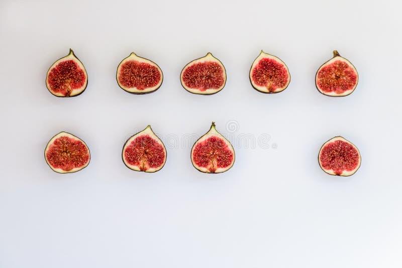 Modelo de los higos maduros cortados bajo la forma de rectángulo aislados en el fondo blanco Ejemplo de la fruta Foto de la comid fotos de archivo libres de regalías