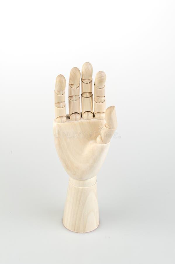 Modelo de madeira articulado da mão foto de stock