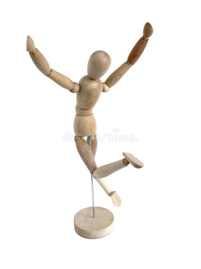 Modelo de madera miniatura que salta para la alegría (posterior) imagen de archivo libre de regalías