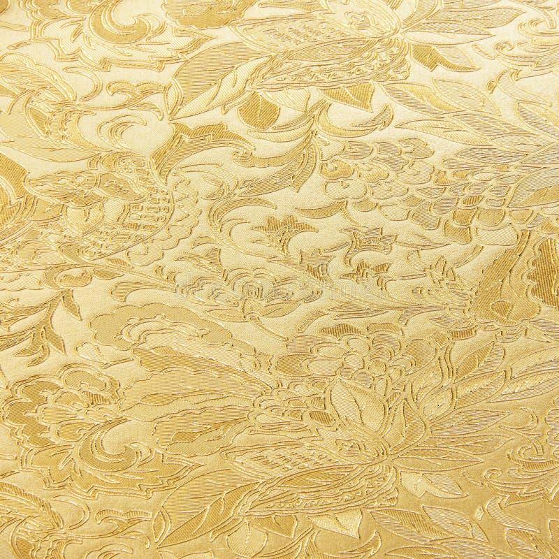Modelo de oro de la materia textil del brocado del ornamento floral fotos de archivo libres de regalías