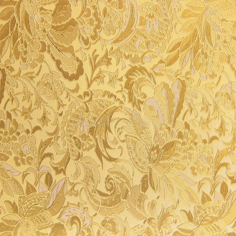 Modelo de oro de la materia textil del brocado del ornamento floral imágenes de archivo libres de regalías