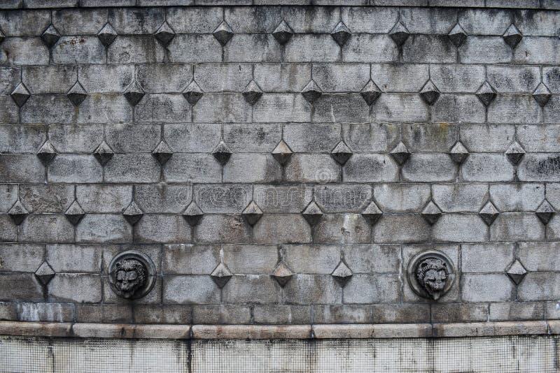 Modelo de piedra antiguo de los bloques en la superficie de la pared de la fortaleza Fondo de piedra gris con estilo medieval eur fotografía de archivo libre de regalías