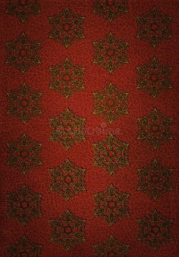 Modelo del copo de nieve del oro en el cuero rojo foto de archivo