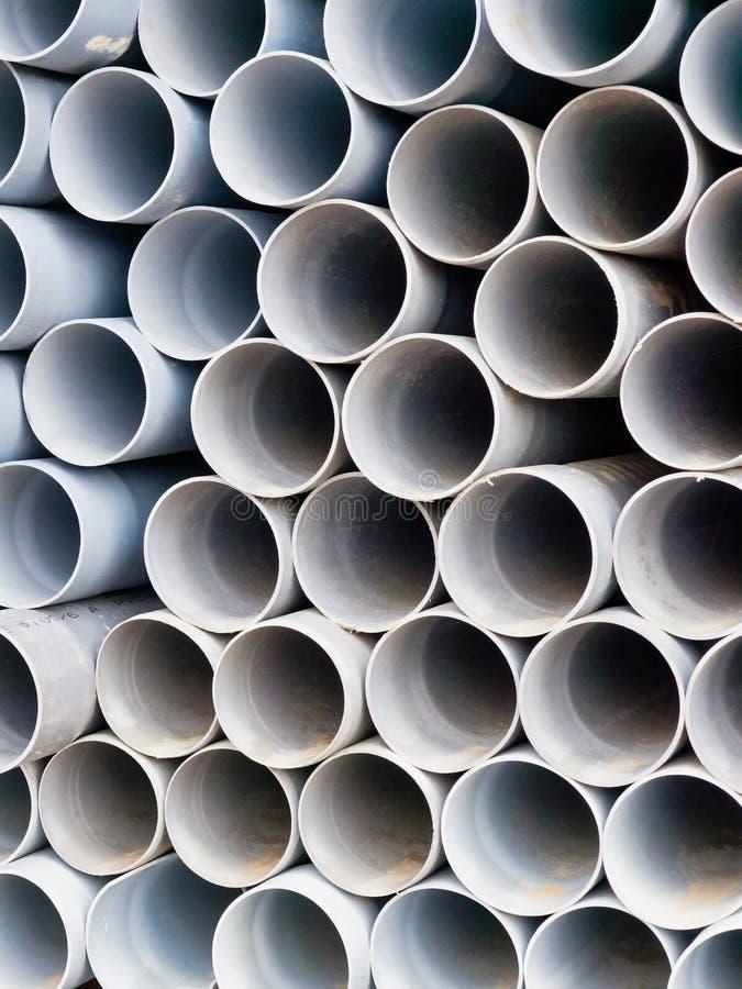 Modelo del detalle de muchos tubos de agua plásticos apilados imágenes de archivo libres de regalías