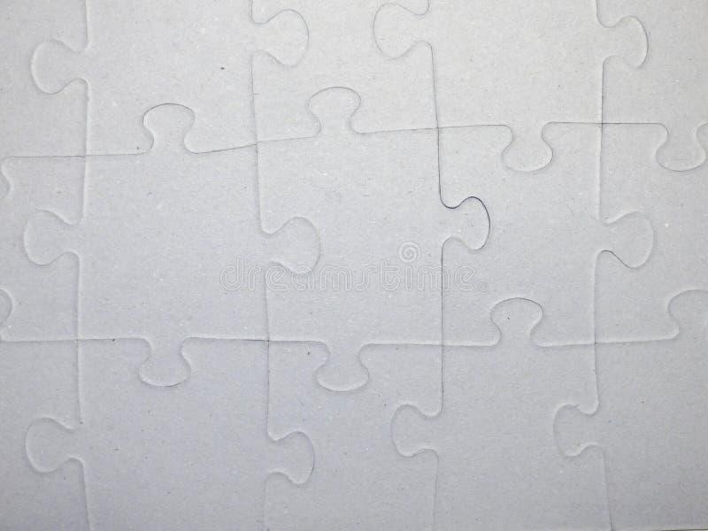 Modelo del rompecabezas hecho del cartón gris foto de archivo libre de regalías