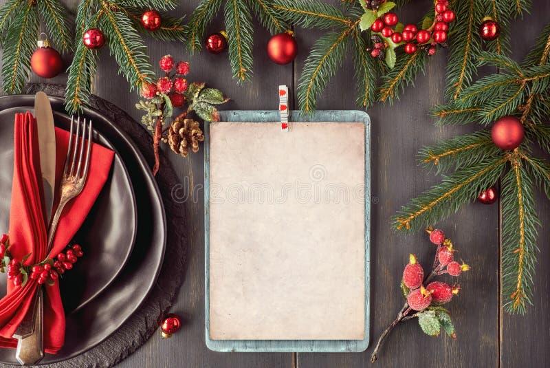 Modelo do menu do Natal no fundo escuro, espaço fotos de stock