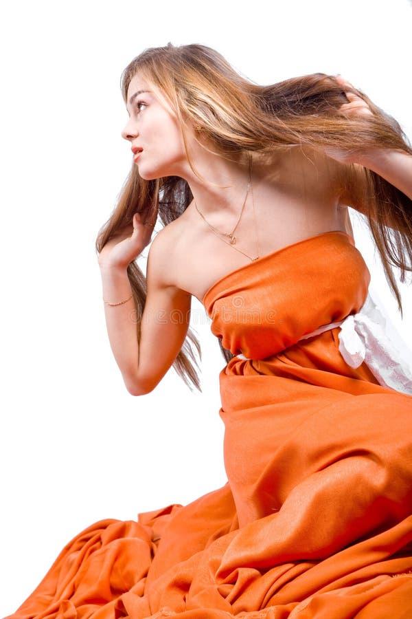 Modelo en alineada anaranjada foto de archivo libre de regalías