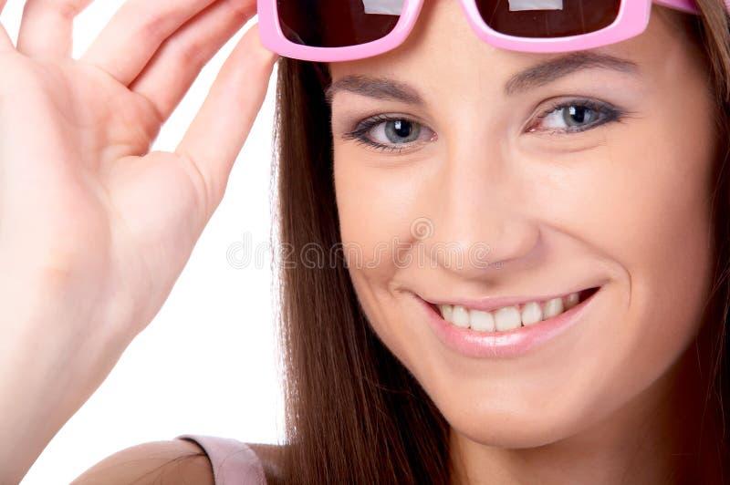 Modelo en gafas de sol rosadas fotos de archivo libres de regalías