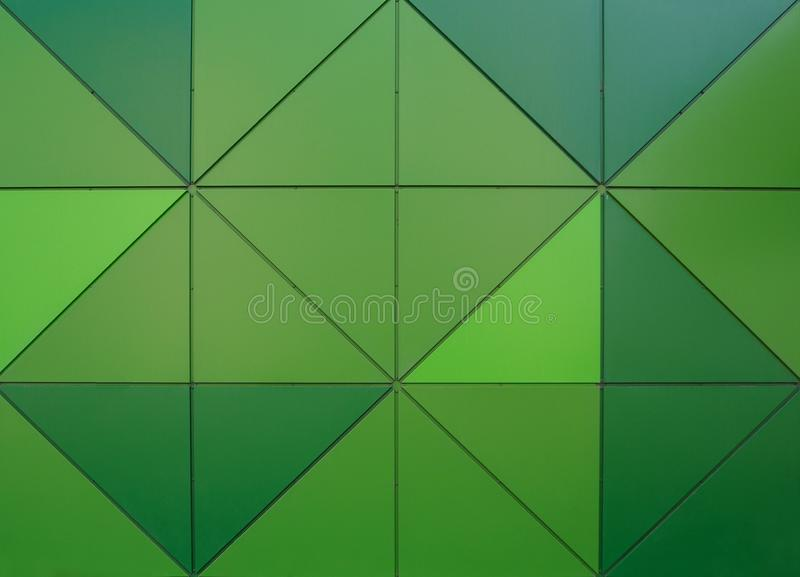 Modelo geométrico de los triángulos del verde del extracto foto de archivo libre de regalías