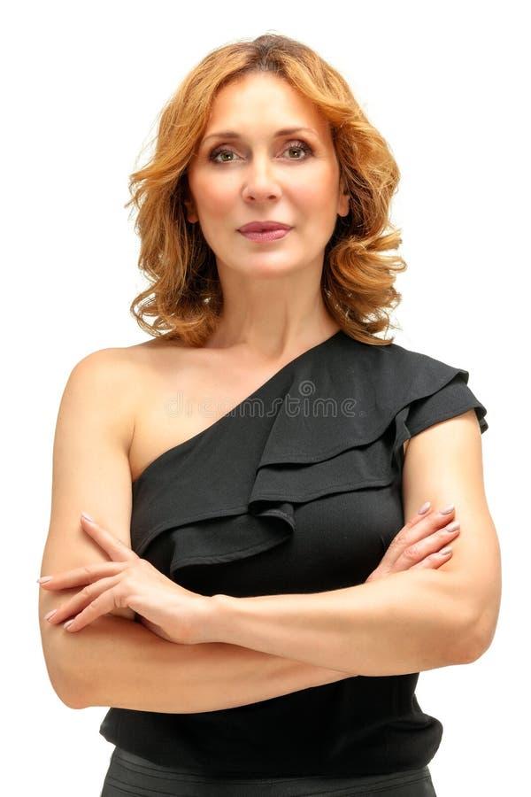 Modelo hermoso de la mujer adulta en el fondo blanco fotografía de archivo
