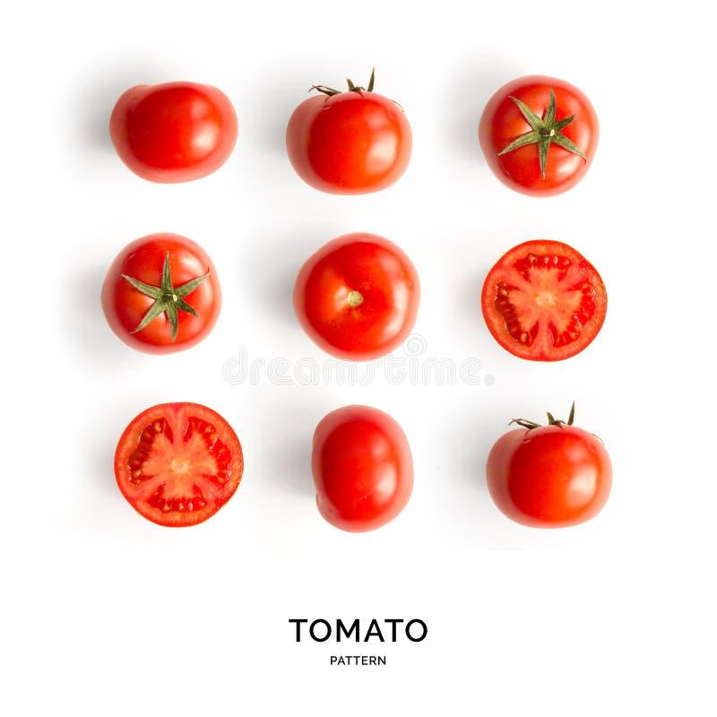 Modelo inconsútil con los tomates abstraiga el fondo Tomate en el fondo blanco imagen de archivo