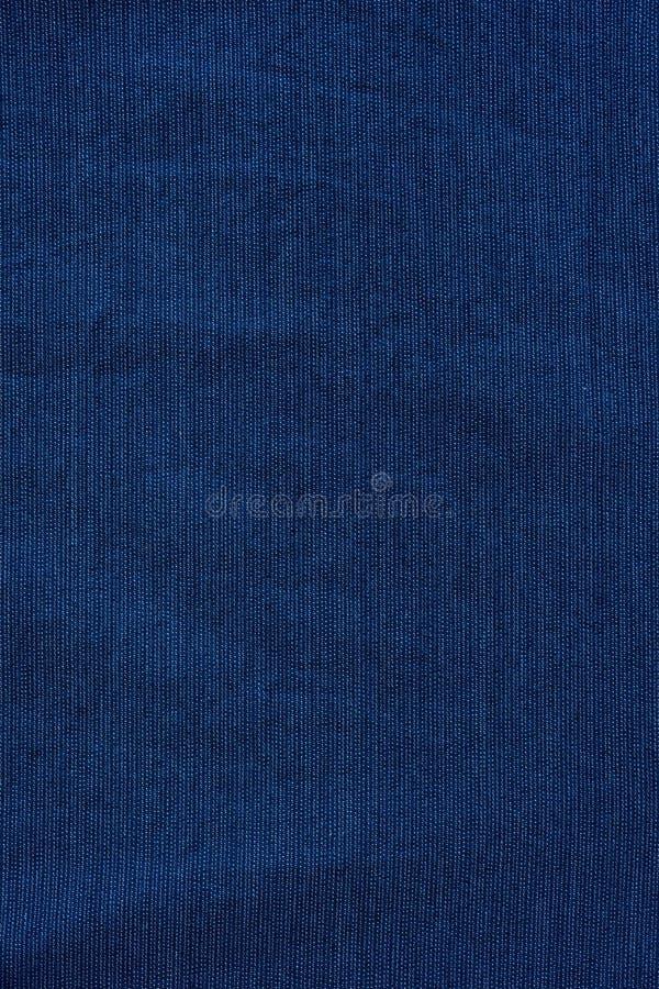 Modelo inconsútil del dril de algodón de la textura del extracto azul del fondo imagen de archivo
