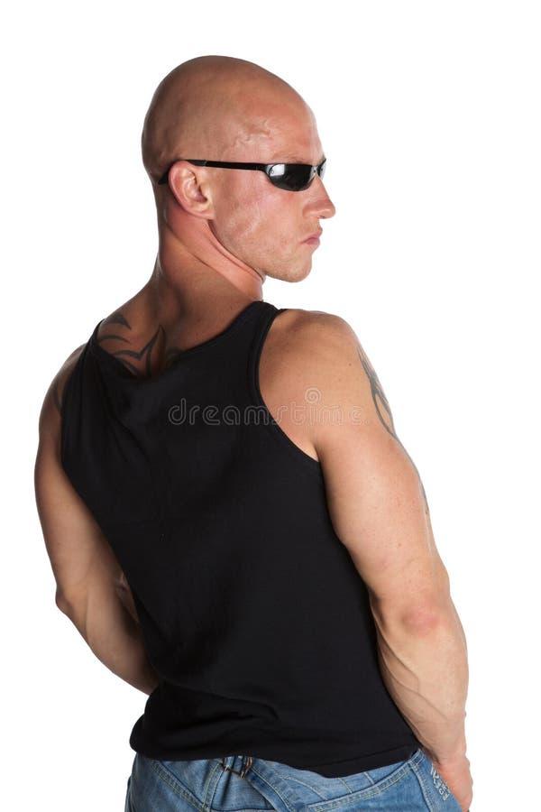 Modelo masculino apto con los tatuajes foto de archivo