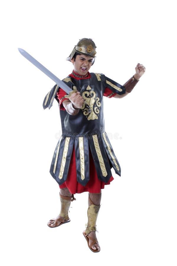 Modelo masculino en el traje romano del soldado fotos de archivo libres de regalías