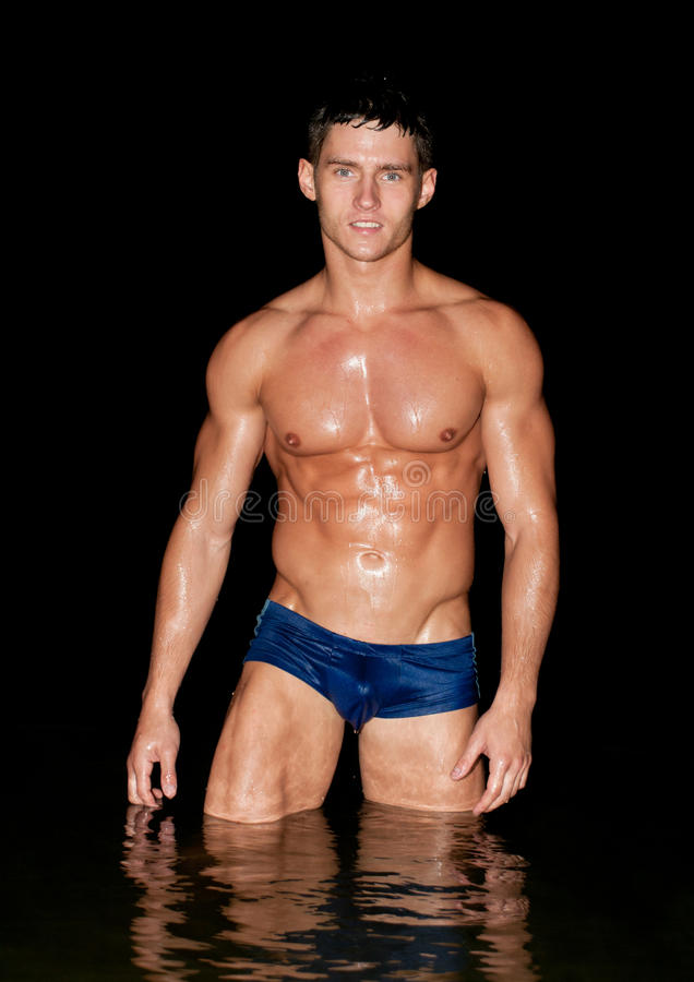 Modelo masculino na água fotografia de stock royalty free