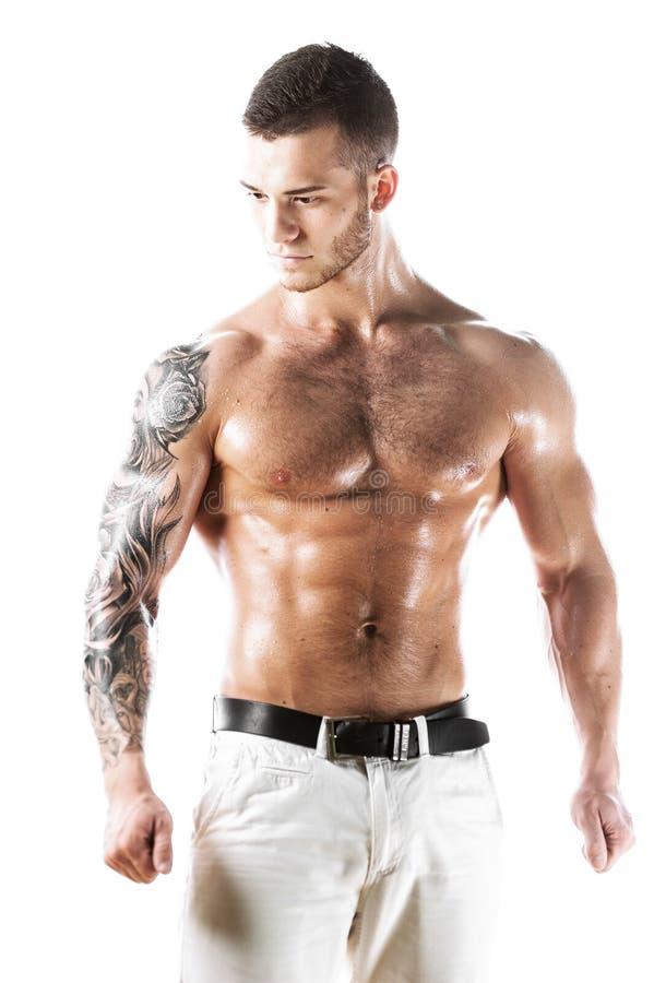 Download Modelo Muscular Atractivo De La Aptitud Con El Torso Tatuado Imagen de archivo - Imagen de atlético, energía: 100531161