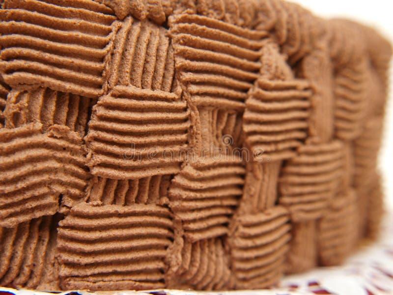 Modelo poner crema del chocolate imagenes de archivo