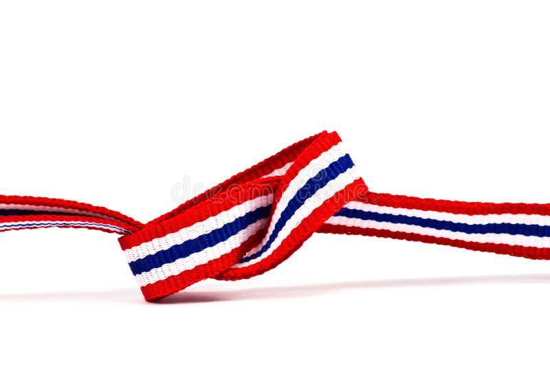 Modelo tailandés de la cinta de la bandera en el fondo blanco y el área en blanco fotografía de archivo