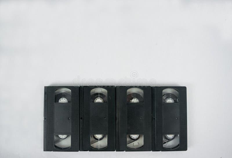 Modelo video da cassete de banda magnética quatro nos fundos brancos fotografia de stock royalty free