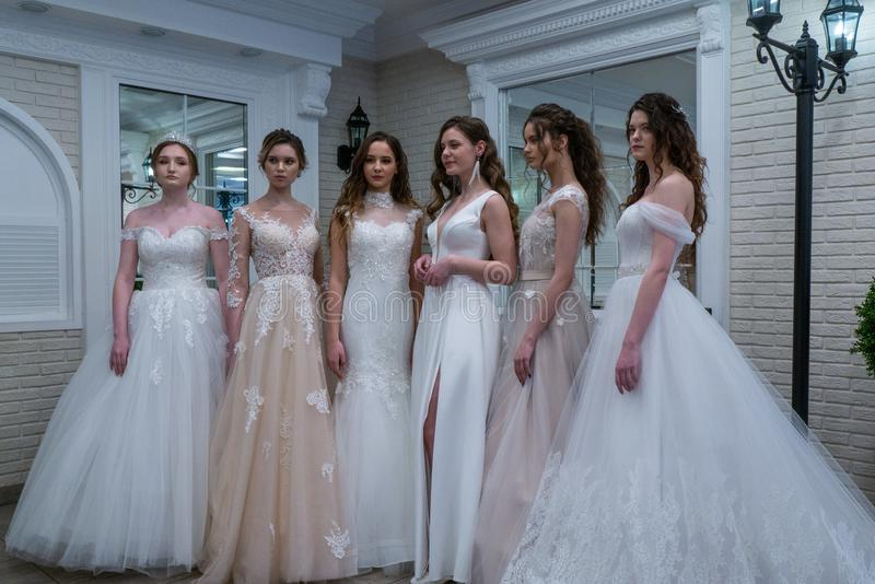 Bride models in wedding dresses. Models playing brides in wedding dresses at the Wedding Hassle 2019 exhibition took place in Kirov, Russia stock photography