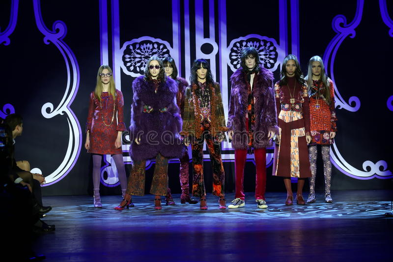 Models pose on the runway at the Anna Sui Fall 2016 show. NEW YORK, NY - FEBRUARY 17: Models pose on the runway at the Anna Sui Fall 2016 show during New York stock photo