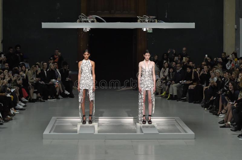 Models pose on the runway during the Chalayan show. PARIS, FRANCE - OCTOBER 02: Models pose on the runway during the Chalayan show as part of the Paris Fashion royalty free stock photos