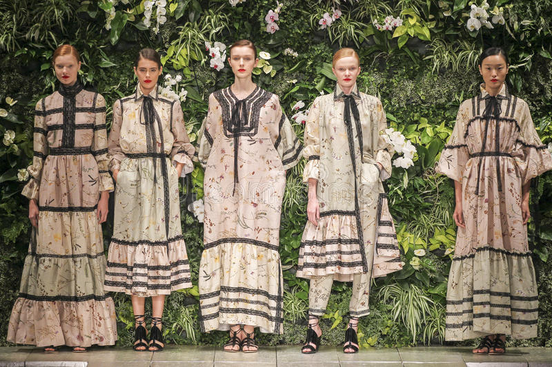 Models pose on the runway during the Laura Biagiotti fashion show. MILAN, ITALY - SEPTEMBER 27: Models pose on the runway during the Laura Biagiotti fashion show royalty free stock images