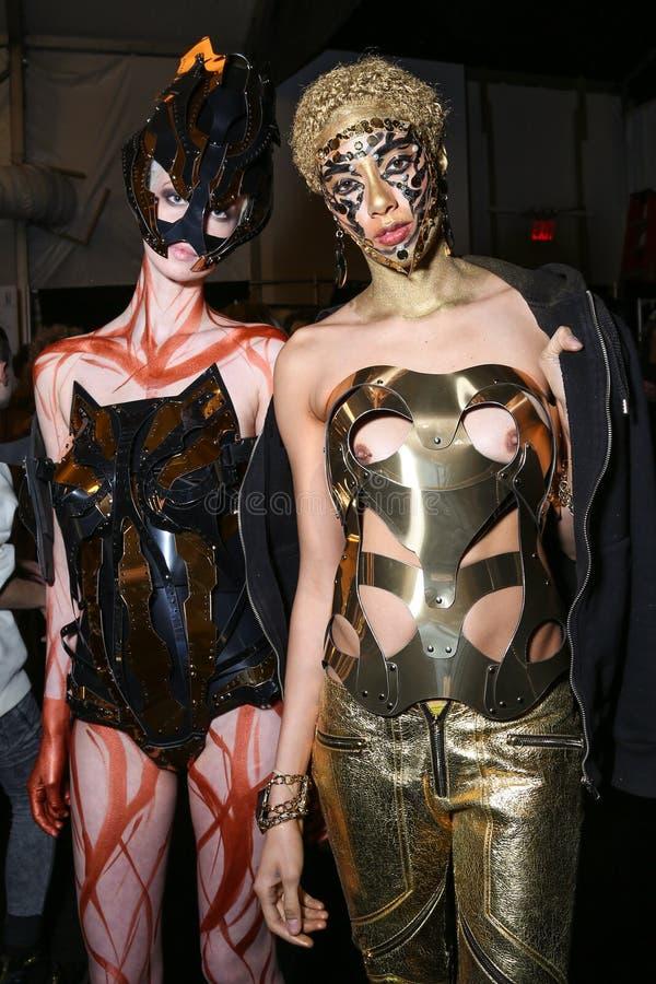 Models posing backstage at the FTL Moda fashion show during MBFW Fall 2015. NEW YORK, NY - FEBRUARY 15: Models posing backstage at the FTL Moda fashion show stock image