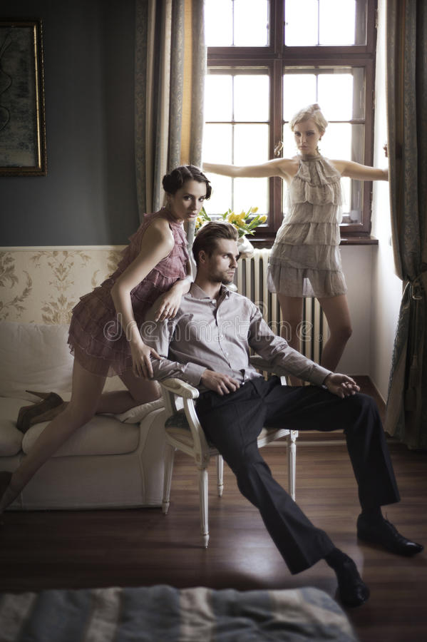 Models Posing In A Stylish Interior Stock Photography