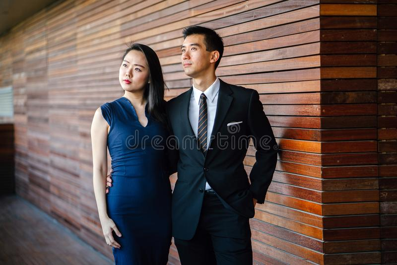 Models posing. an and Woman Standing Next to Each Other Looking Upward stock photo